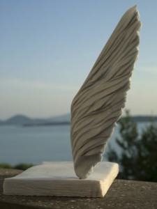 "Messaggi d´Amore, Love messages, one of the sculptures of the ""Garden of Poetry"". In the background you see Trasimeno Lake"