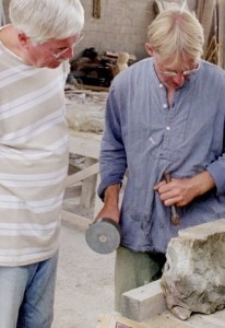 Wolfgang Sandt shows to one of his students how to use stone masons tools.